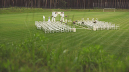 Wedding Set Up In Football Field. Outside Wedding Ceremony. Wedding Aisle Decor stock footage