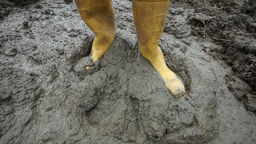Rubber Boots Stepping In Muddy Ground stock footage