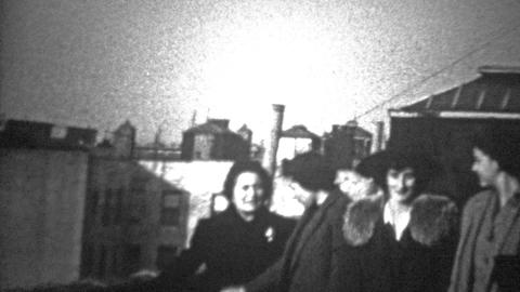 NEW YORK CITY - 1943: Women introducing themselves on a rooftop Footage