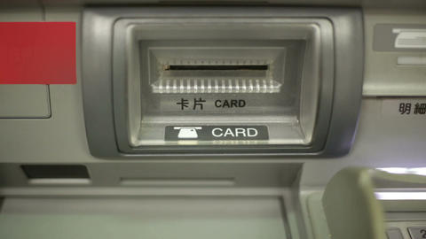 Bank Card Ejecting From ATM Card Slot, Shot From Front stock footage