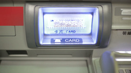 Bank card ejecting from ATM card slot, shot from front Stock Video Footage