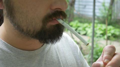 Bearded Man Smokes Footage