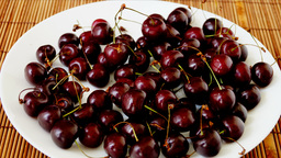 Plate with very ripe cherries, emptying.Stop Motion, Static Shot Footage