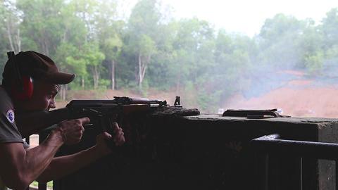 man firing an AK-47 rifle at the Chi chu tunnel firing range Footage