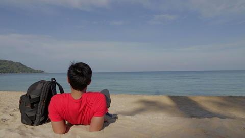 Asian man relaxes at Thailand beach Footage