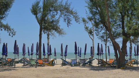 A Row Of Beach Chairs And Umbrella At The Beach, Thailand stock footage
