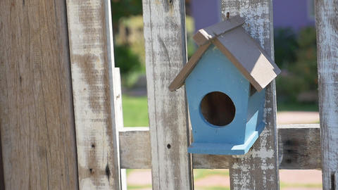 Wooden Bird House On The Fence, Pan Shot stock footage