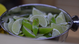 Fresh sliced lime in a saucepan Footage