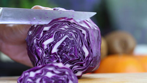Hand Slicing A Purple Cabbage With A Knife, Close Up stock footage