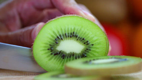 Hand Slicing A Kiwi With A Knife, Close Up stock footage