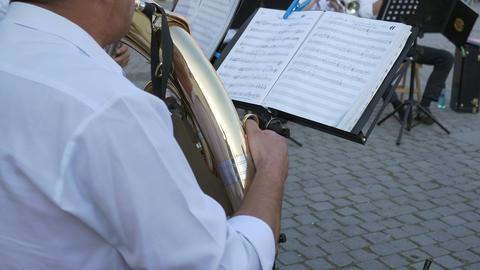 Brass Player Follows Music Sheets Footage