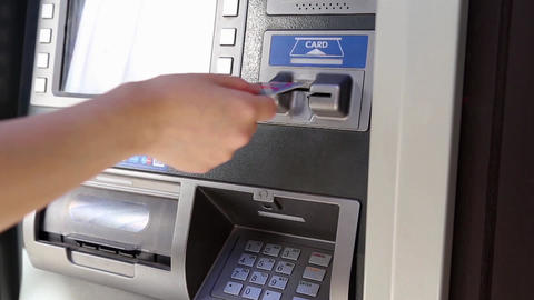 Detail Of A Woman's Hand Inserting A Bank Card At An ATM stock footage