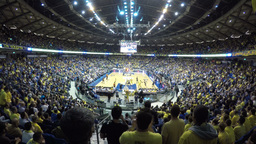 4k Basketball game with yellow shirt fans Footage