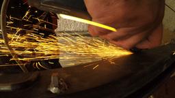 Extreme close up on grinder creating sparks in 4k Footage