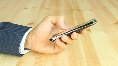 Businessman Use Finger Slide and Touch Screen of Smart... 動画素材, ムービー映像素材