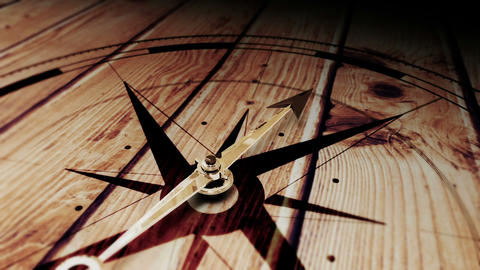 Compass pointing on wooden surface Animation