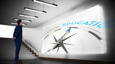 Businessman viewing education compass clip Animation