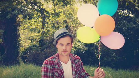 Handsome hipster holding balloons Footage