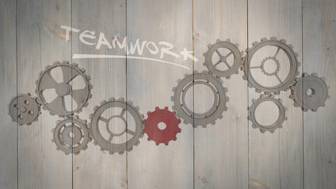 Cogs and wheels turning on wooden background Animation
