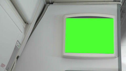 Monitor with a green screen inside the aircraft Live Action