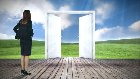 Door opening to green meadow watched by businesswoman Animation