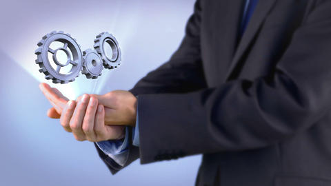 Businessman presenting cogs and wheels graphic Animation