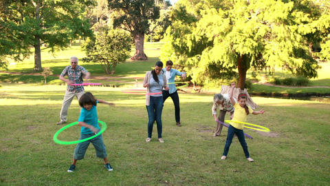 Extended family playing with hula hoops Footage