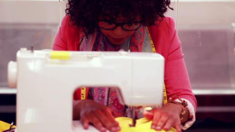 Fashion designer using sewing machine Footage