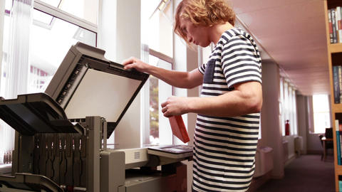 Student using a photocopier Live Action