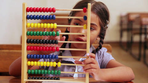 Cute pupil learning maths with an abacus Footage