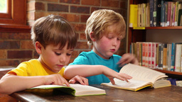 Cute pupils reading in library Footage
