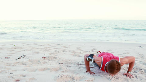 Fit man doing push ups on the beach Footage