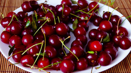 Plate With Mouthwatering Cherries, Stop Motion, Zoom Out Footage