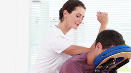 Physiotherapist giving shoulder massage to patient Footage