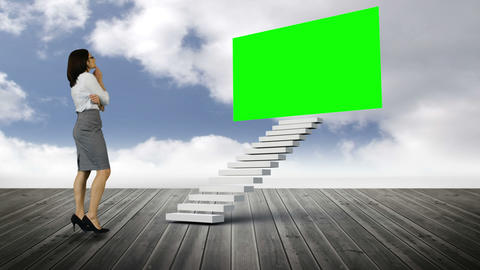 Businesswoman looking at stair with a green screen on wood ground Animation