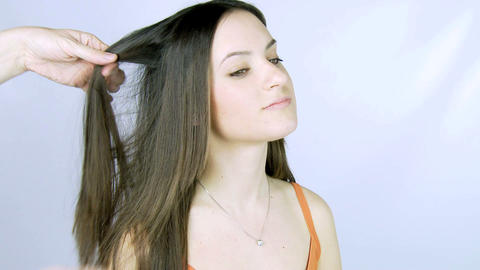 Girl getting long hair ironed Stock Video Footage