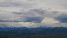 Cloudy landscape with mountain hills covered by snow Stock Video Footage