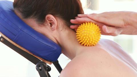 Woan having back massage with massage ball Footage