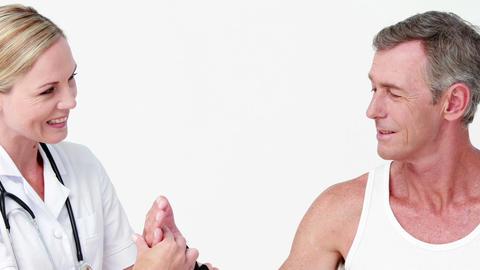 Doctor examining a man wrist Footage