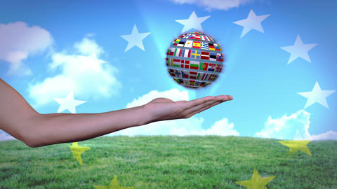 Ball made of European nationals flags turning on hands Animation