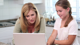 Mother And Daughter Using Laptop stock footage