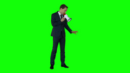 Businessman speaking in megaphone on green screen Live Action