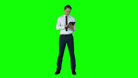 Businessman using tablet computer Live Action