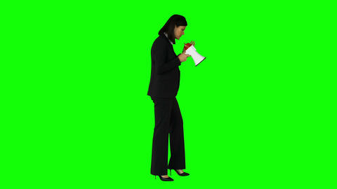 Businesswoman speaking in megaphone on green screen Live Action
