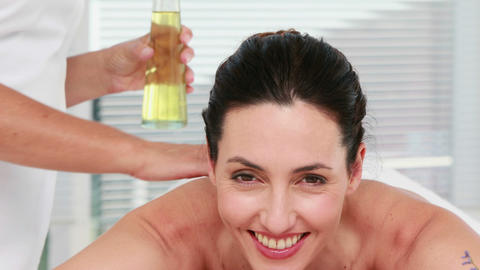 Smiling woman getting an aromatherapy treatment Footage