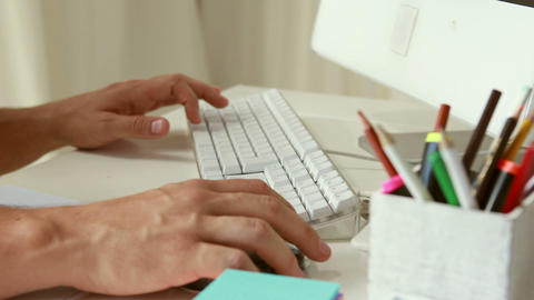Man writing with keyboard in his computer Live Action