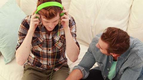 Men Listening Music On A Sofa stock footage