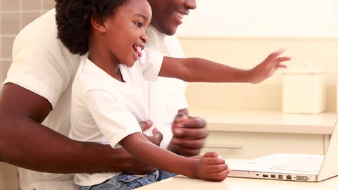 Child With His Father Using Video Online On The Computer stock footage