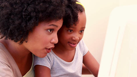 Child With Her Mother In The Computer stock footage