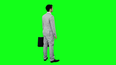 Businessman standing holding his briefcase Footage